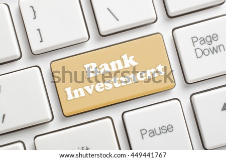 Brown bank investment key on keyboard - stock photo