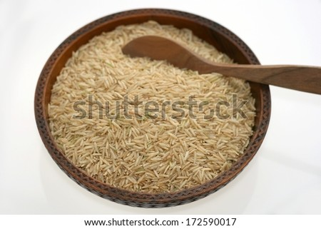 Brown basmati rice, long grain rice from South Asia - stock photo