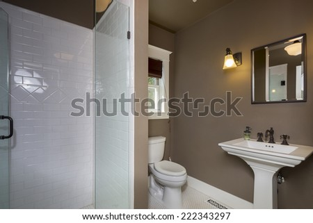 Brown Bathroom with white shower.  - stock photo