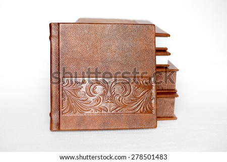 Brown books in leather covers with beautiful pattern - stock photo