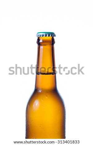 Brown bottle of beer with drops on a white background - stock photo