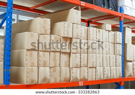 brown box parcel on shelf in warehouse - stock photo