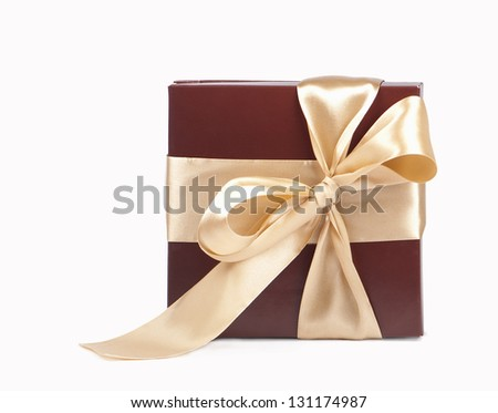 brown box with candies and golden tape on a white background - stock photo