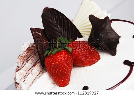 brown bread and strawberries, white background. - stock photo