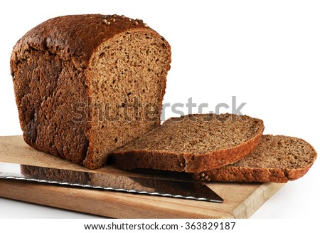 Brown bread on a white background. Bread knife. - stock photo