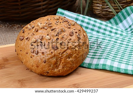 Brown bread with seeds - stock photo