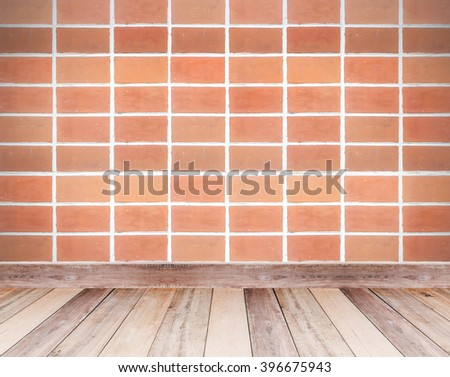 Brown brick wall and wooden floor tiles for background - stock photo