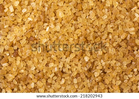 brown cane sugar in the form of background - stock photo