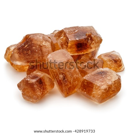 Brown caramelized lump cane sugar cube isolated on white background cutout - stock photo