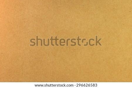 Brown cardboard background. Brown cardboard texture. Paper texture. Paper background. Abstract paper texture. Paper box texture. Paper box wallpaper. Grunge paper box texture. Simple texture. Texture - stock photo