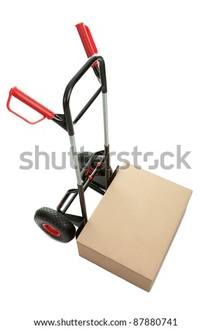 Brown cardboard box on hand truck isolated over white background - stock photo