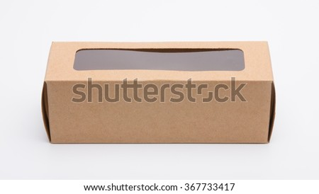 Brown cardboard box with window cut - stock photo