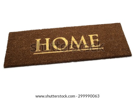 Brown carpet doormat with text Home isolated on white background - stock photo