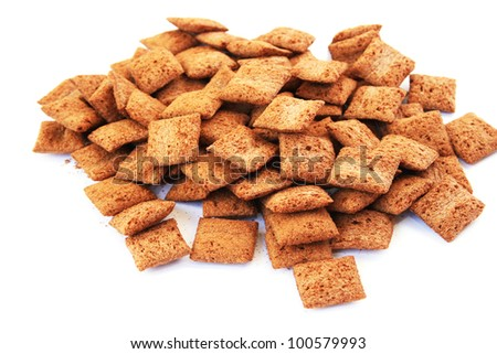 Brown cereal isolated on white background. - stock photo