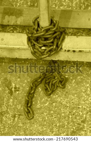 brown chains on the metal railing, give people a feeling of depression - stock photo