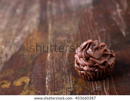 Brown chocolate candy on dark wood background - stock photo