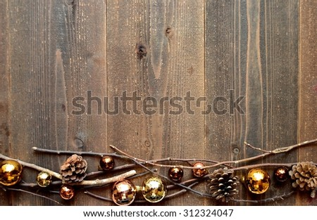 Brown Christmas ornament balls with pine cones.frame - stock photo