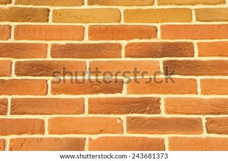 Brown cladding tiles imitating bricks in sunny day  - stock photo