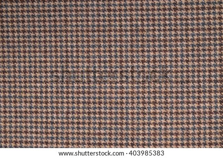 Brown classic tweed textile surface. Fashion, textures and backgrounds - stock photo