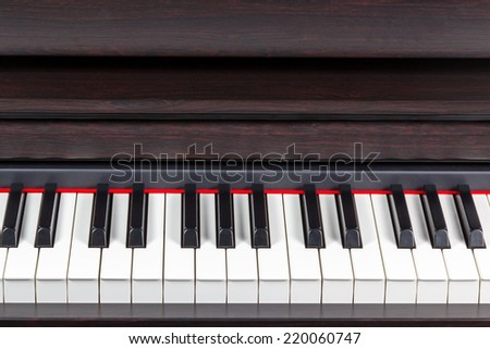 Brown classical piano keys closeup with open lid - stock photo