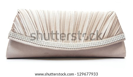 brown clutch bag with jewel on white background - stock photo