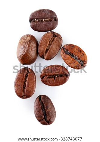 Brown coffee beans isolated on white - stock photo