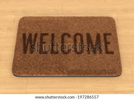 Brown coir doormat with text Welcome on wooden floor - stock photo