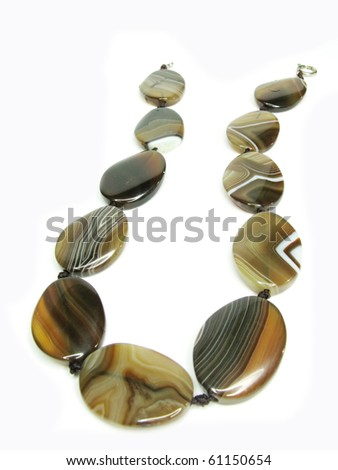 brown colored agate beads isolated on white background - stock photo