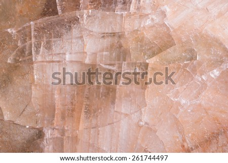 Brown colored ice texture background made of frozen ice - stock photo