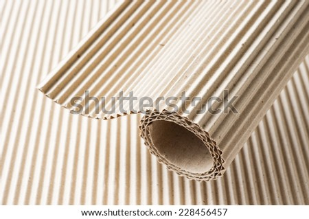 brown corrugate paper roll from recycle paper - stock photo