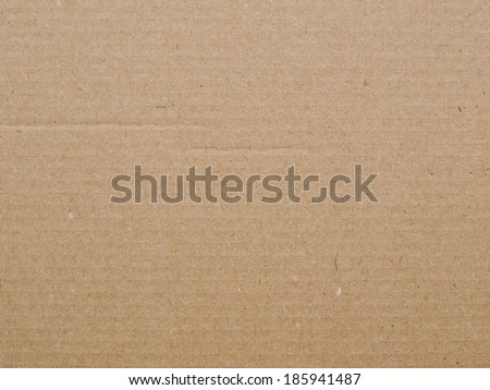 Brown corrugated cardboard sheet useful as a background - stock photo