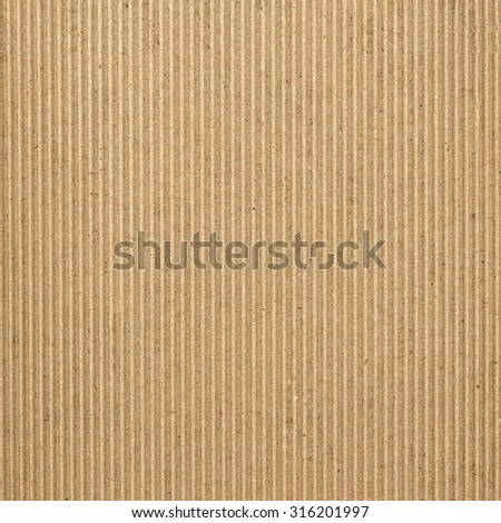 Brown corrugated cardboard texture useful as a background - stock photo