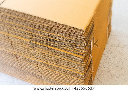 Brown corrugated cardboard with selective focus and blur effect - stock photo