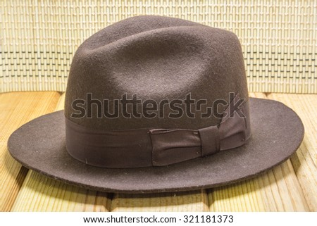 brown cowboy hat  close up shoot on wooden background - stock photo