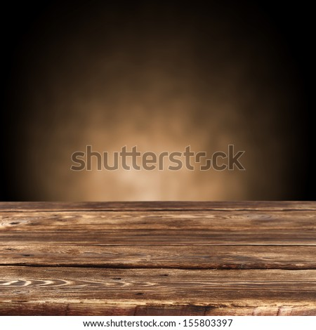 brown dark space and brown old desk  - stock photo