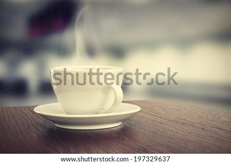 brown desk and coffee cup  - stock photo