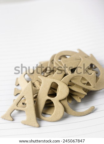 brown diet cut alphabet step together - stock photo