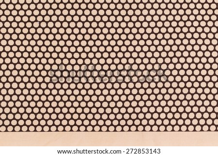 brown dots over dark brown Polka dot fabric background and texture - stock photo