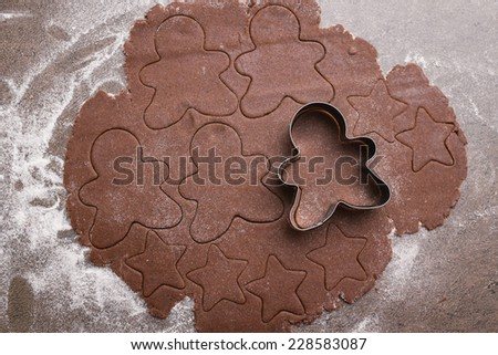 Brown dough and gingerbread man cutter - stock photo