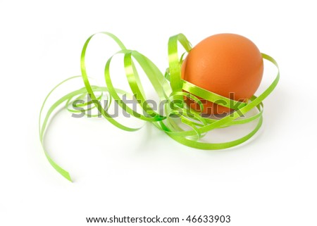Brown egg wrapped around with green ribbon over white background - stock photo