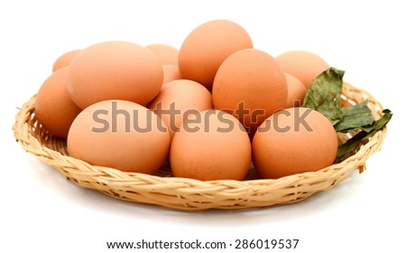 Brown Eggs on bamboo basket - stock photo