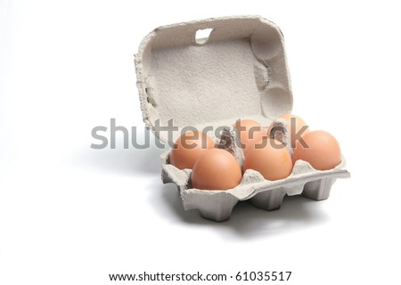 Brown Eggs on Carton with White Background - stock photo