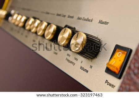 brown Electric guitar amplifier button on white background - stock photo