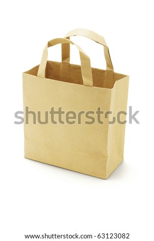Brown empty paper bag on white background - stock photo