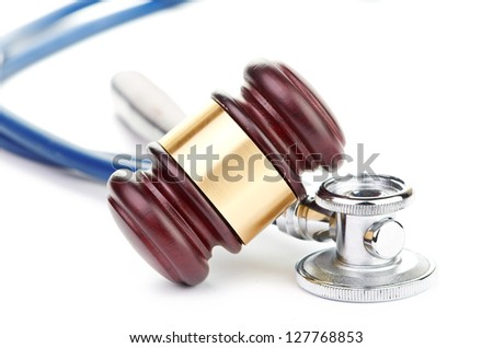 brown gavel and a medical stethoscope on white background - stock photo