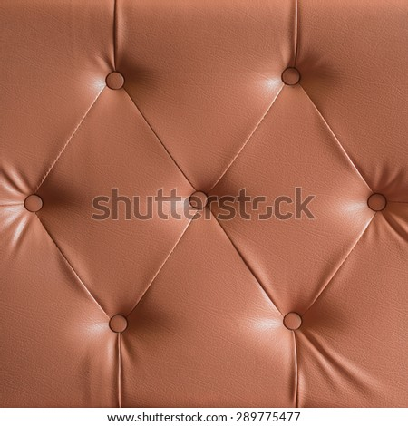 brown genuine leather sofa pattern as background image - stock photo