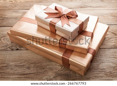 Brown gift boxes on the old board - stock photo