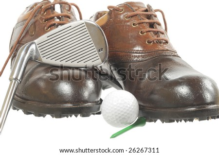 Brown golf shoes, ball and iron on white - stock photo
