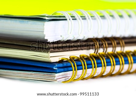 Brown, green, yellow note book collection. - stock photo