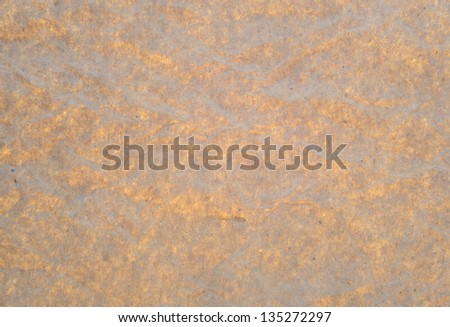 Brown greyish paper with a light glow through. - stock photo